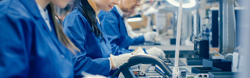People working blue labcoats header.jpg