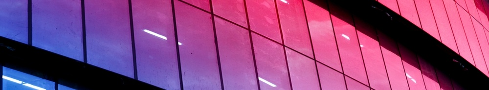 Modern glass building red banner 1086x202